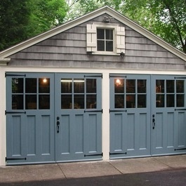 The little cottage on the pond exterior upgrades for Carriage style garage doors with windows
