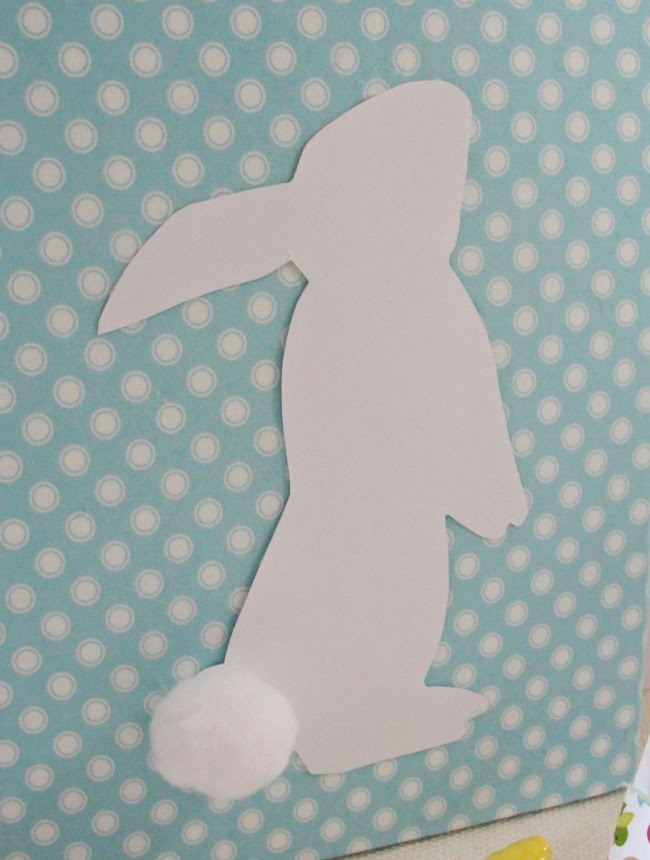 art canvas covered with fabric with a cute paper bunny