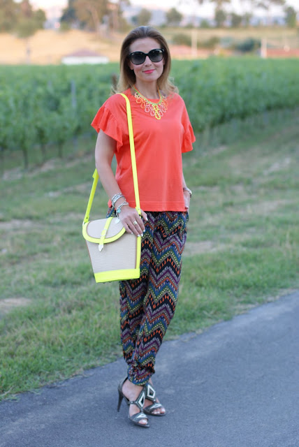 Summer outfit with light printed pants, neon color straw bucket bag, Fashion and Cookies