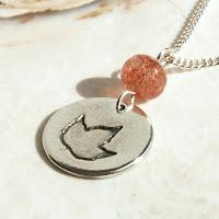 orange sunstone fall leaf charm necklace in fine and sterling silver by Jennifer Kistler