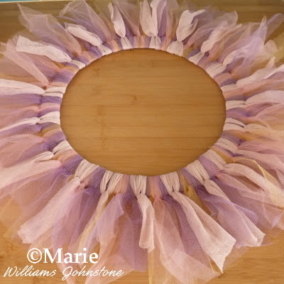 Tulle strips of netting tied around a wreath base