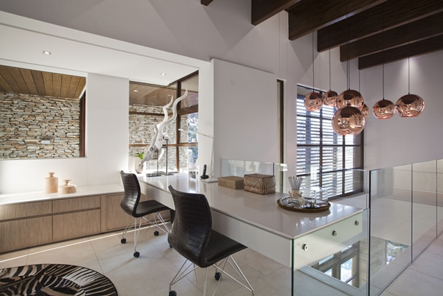 Home office on the first floor inside of Contemporary South African SGNW House by Metropole Architects