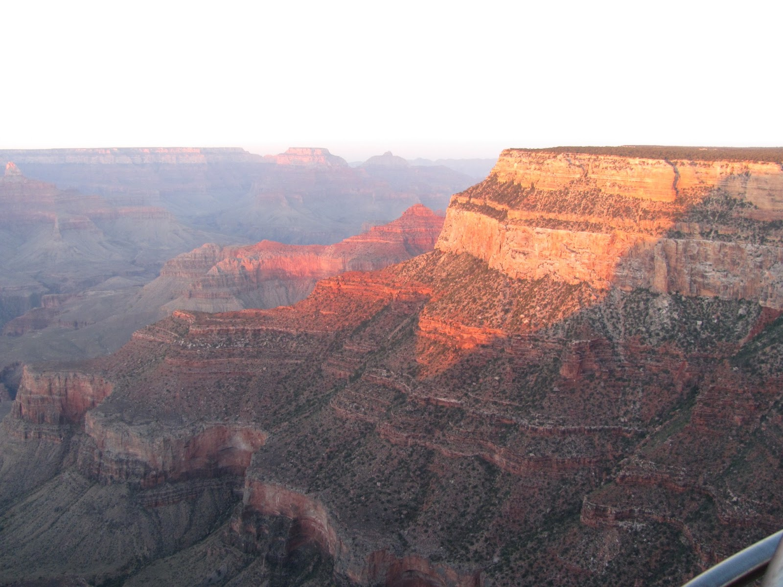 Sunset settles into Grand Canyon as layers of different rock are seen at Grand Canyon National Park, Arizona