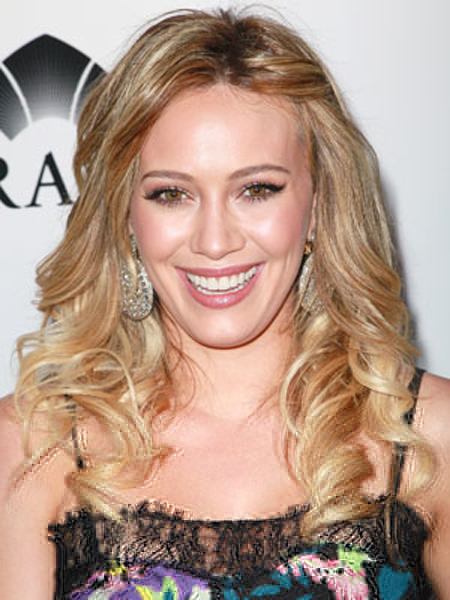 Hilary Duff nails it with this perfect spring look: Blonde bouncy curls, a pinned-back side and a floral top