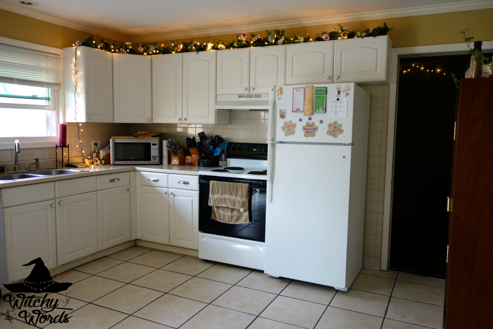 In The Kitchen I Replaced The Garland Over Our Cabinets With Spring Flowers
