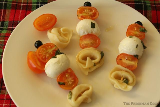 tortellini, tomatoes, fresh basil, mozzarella bites, vinaigrette
