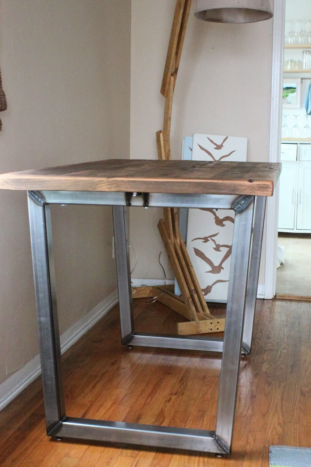 The polish carpenter rustic dining table with metal legs for Rustic iron table legs