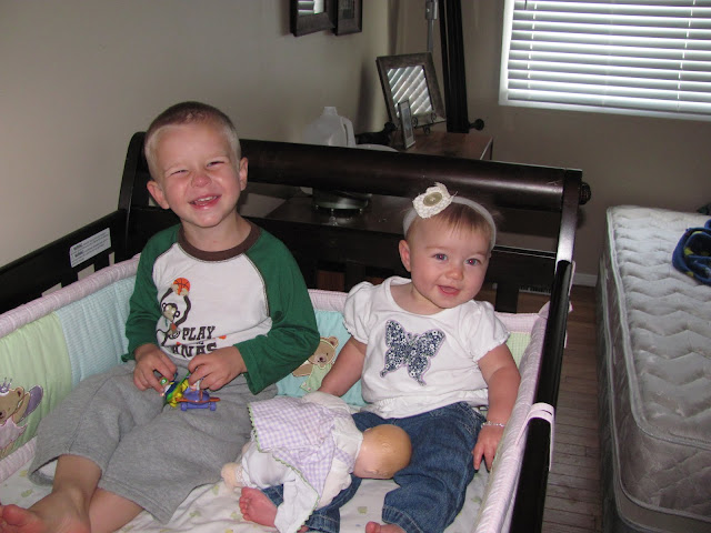 One of Dereks new favorite things is to climb into Chloes crib. They both are such happy kids.