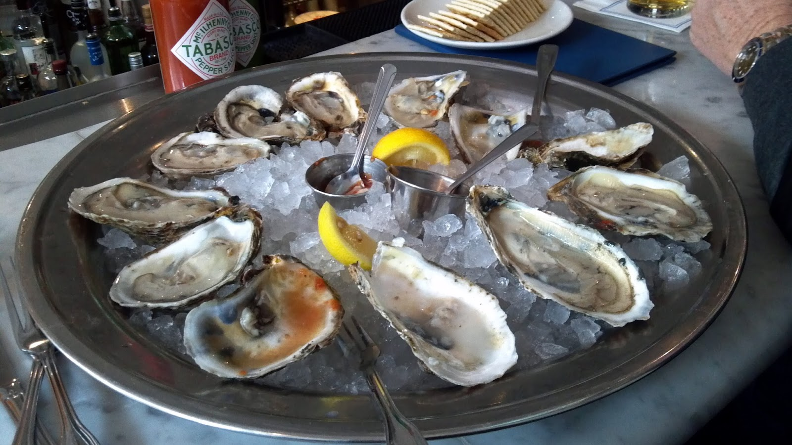 dozen oysters shucked on ice and toppings