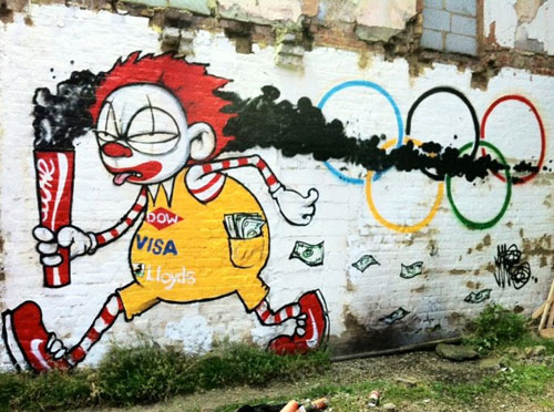 Street art of Ronald McDonald with various commercial endoresements on torch and outfit with cash flowing from his pockets