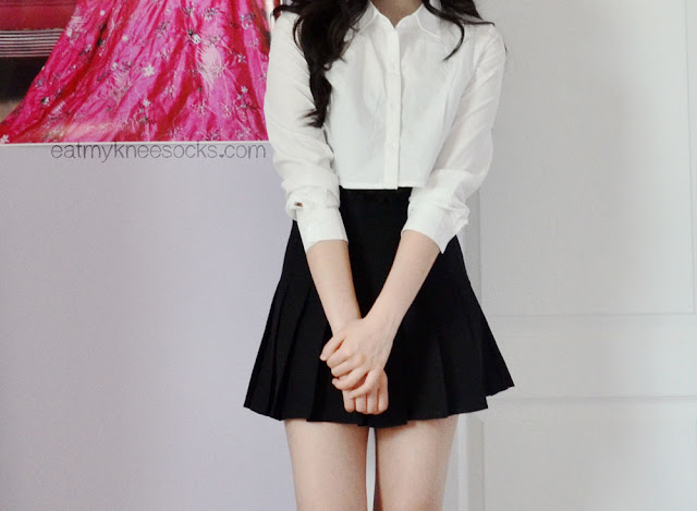 Cute, ulzzang-inspired outfit featuring a cropped button-down top and black pleated American Apparel-dupe tennis skirt from SheInside/SheIn.