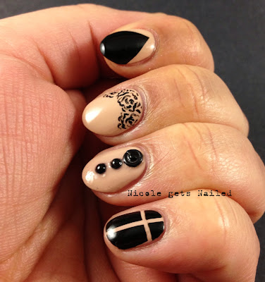 Nude and Black Skittle Nails