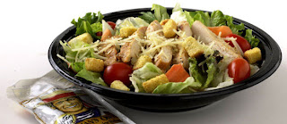grilled chicken salad with veggies and light dressing on the side - a healthy choice