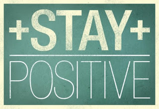 stay postive written on a chalk board