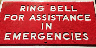 sign that says ring bell for assistance in emergencies