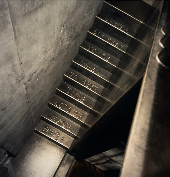 Olson Kundig Architects words stamped in metal stairs