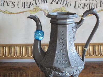 ring displayed on spout of tea pot