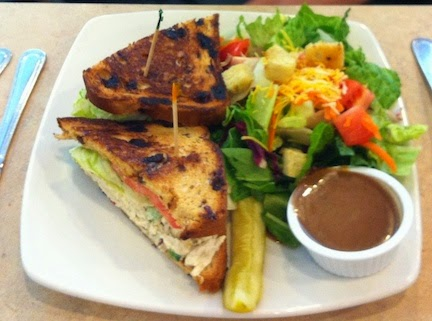 Photo of Chicken Apple Walnut sandwich on Raisin Toast with side salad by Don Taylor