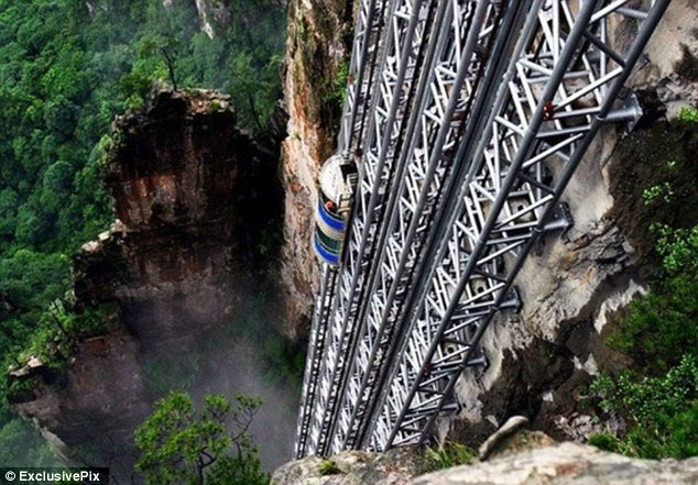 If you suffer from a fear of heights, perhaps this one's not for you.  The Bailong Elevator, also known as the Hundred Dragons Elevator, carries tourists 1,070ft (330m) up the side of a massive sandstone column in a mountain range in China's Hunan Province. Riding the glass lift, which carries up to 50 people at a time or 1,380 an hour, offers jaw-dropping, not to say vertiginous, views down to the bottom of the rocky mountain range in the Wulingyuan area of Zhangijiajie.  Work began on the lift, which cost 120m yuan, or around £12m, in 1999 and finished in 2002. The project met with fierce criticism from environmentalists who were angry that it was sited in the middle of a World Heritage Site.Lift shafts and tunnels had to be dug into the quartz sandstone column chosen from thousands in the area, and earthquake detectors installed so that the lifts (there are three of them) could be evacuated quickly in case of disaster.  Those in favour of the project said that the elevators, which are said to boast the biggest passenger capacity in the world, saved the mountain trails from excess traffic. But protestors said the area, which attracts 5m visitors each year, was already saturated with tourists and did not need another attraction to boost that number further.