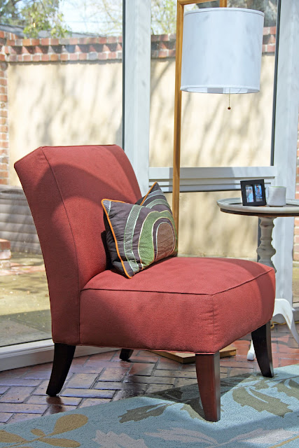 rust colored upholstery on custom slipper chair in sun room