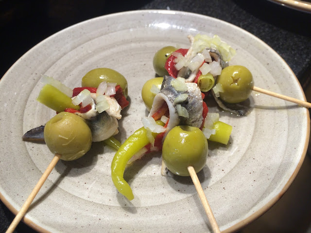 Gilda pintxo - olives, anchovy fillets, spicy peppers and sometimes with onion and olive oil - Basque Country