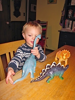 grandson playing with his dinosaur toys