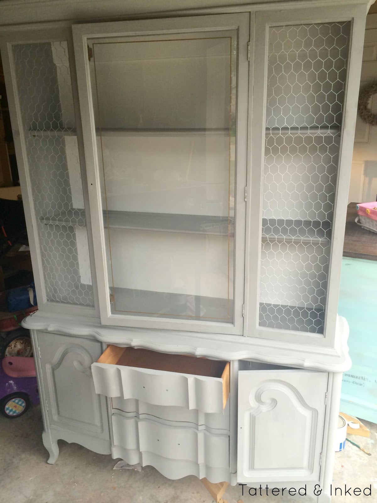 the back wall and inside cabinets got several coats of a pure white