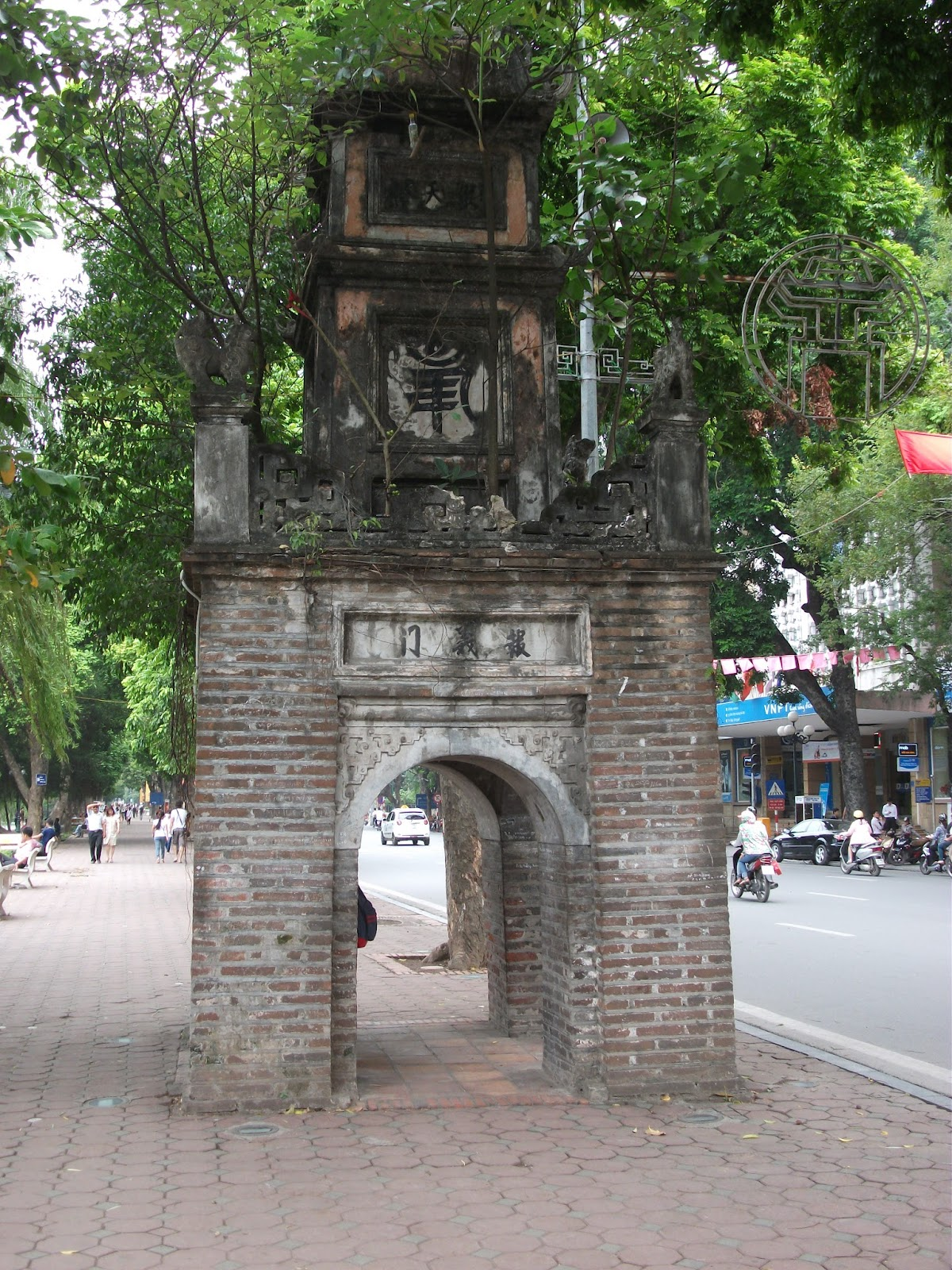 Old structures on the pavement surrounding the Hoan Kiem Lake