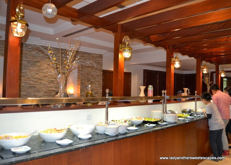 Asian buffet under a wooden pergola in Intramuros Dubai