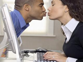 Please Stay Away From Online Dating - man kissing a woman on a computer