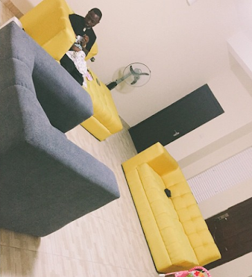 Awww... See This Photo of Davido Feeding his Daughter