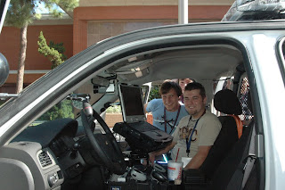 Students check out the technology inside a patrol car.