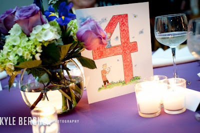 Floral centerpiece and custom tablecard made by the Bride