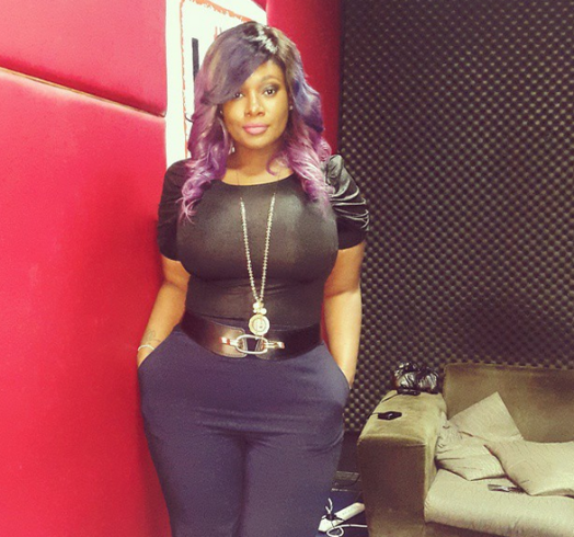 Photo: OAP Toolz shows off her curves and purple weave...