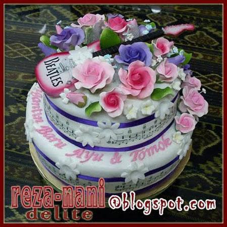 kek perkahwinan tomok