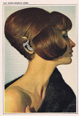 A hairstyle from 1964 features some interesting shapes.