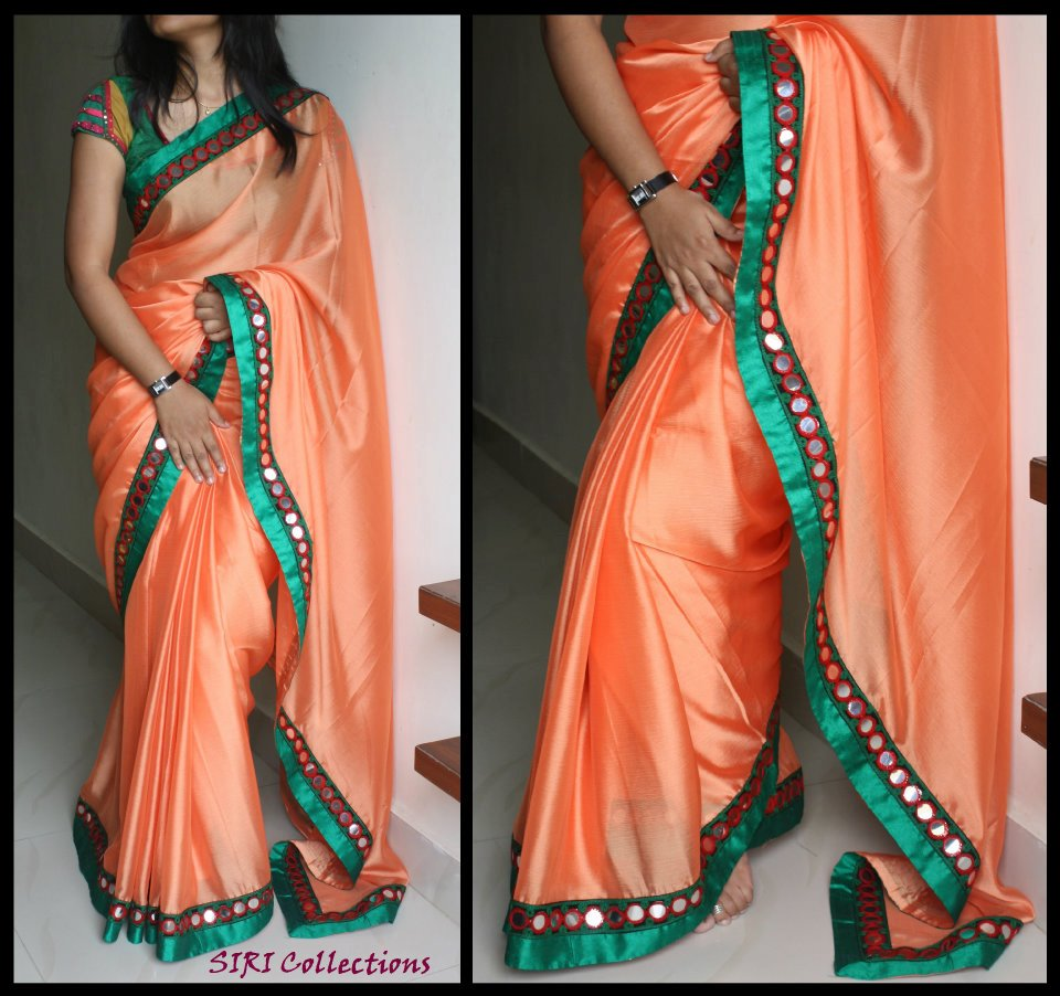 orange colour mirror work sari