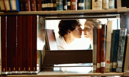 Erotic Everyday Activities  - man and woman kissing in library makeout