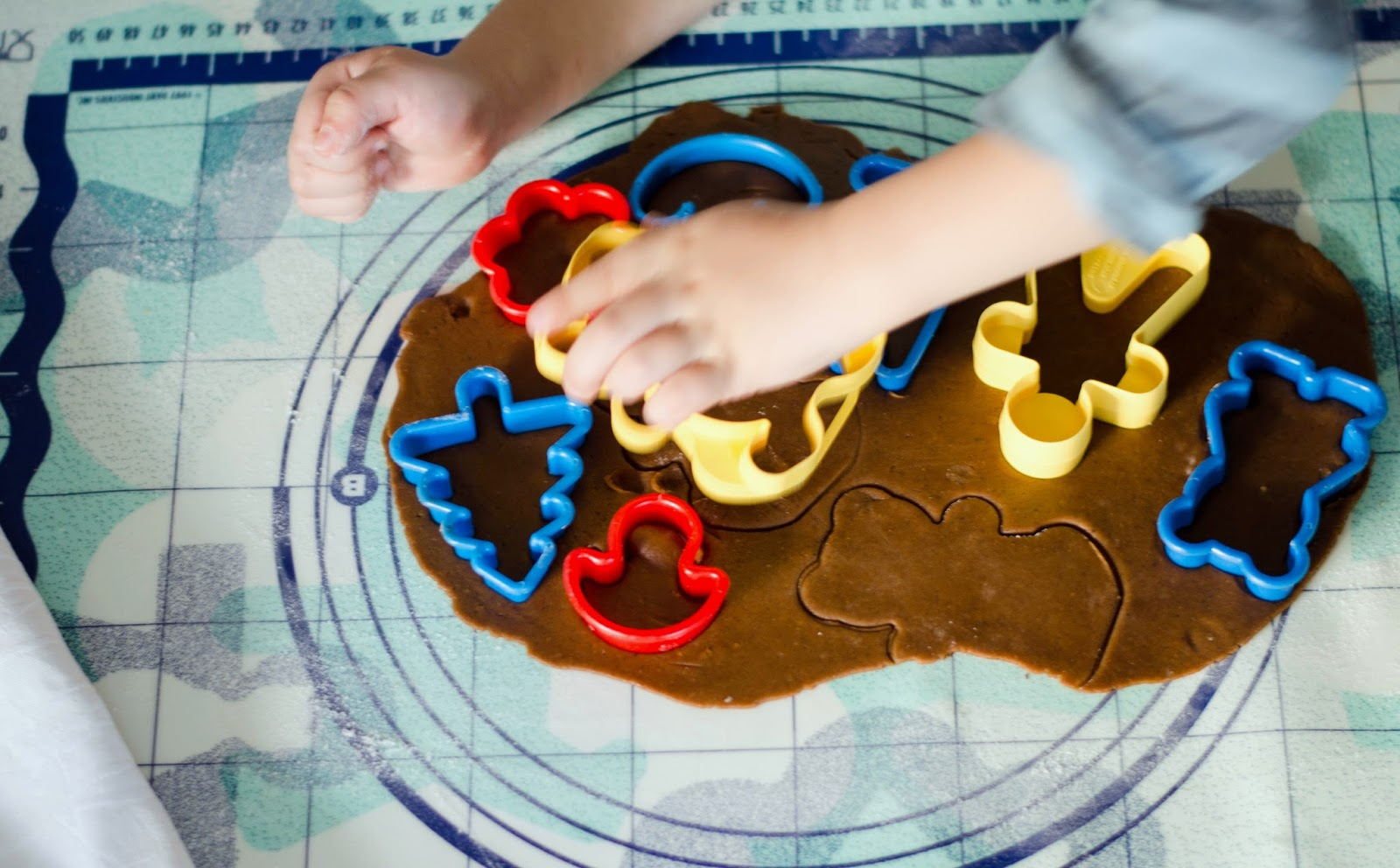 children making gingerbread christmas