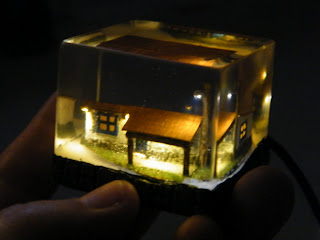 self ilumminated micro house embedded in clear resin