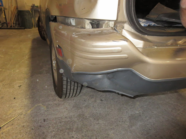 Damaged bumper and quarter panel before repairs at Almost Everything Auto Body