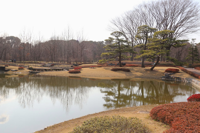 Enticing by a well-maintained park with a pond in the beginning of Spring at Imperial Palace East Garden in Tokyo, Japan