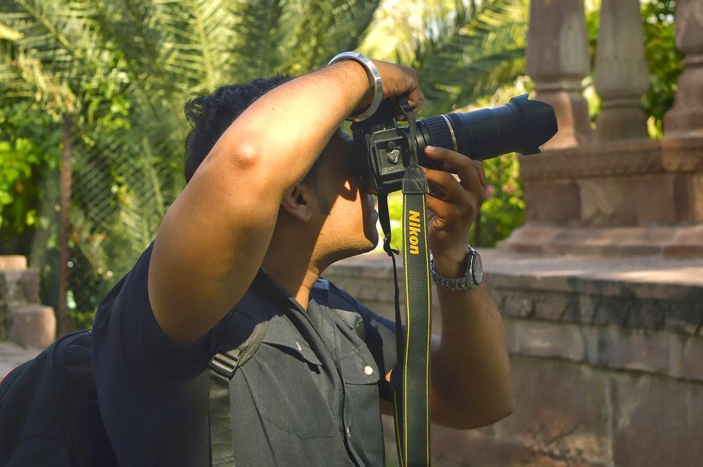 Photographer handling camera
