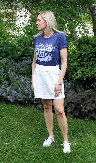 Love More/Hate Less Tee styled with J.Crew skirt and Converse.