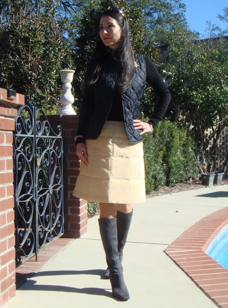 Quilted vest and quilted skirt outfit with head tilted to the side.