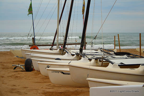 Catamarans on the beach on a cloudy day