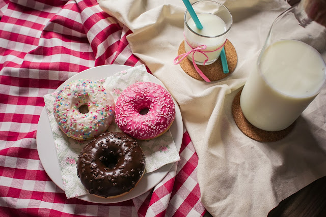 Donuts and milk on table