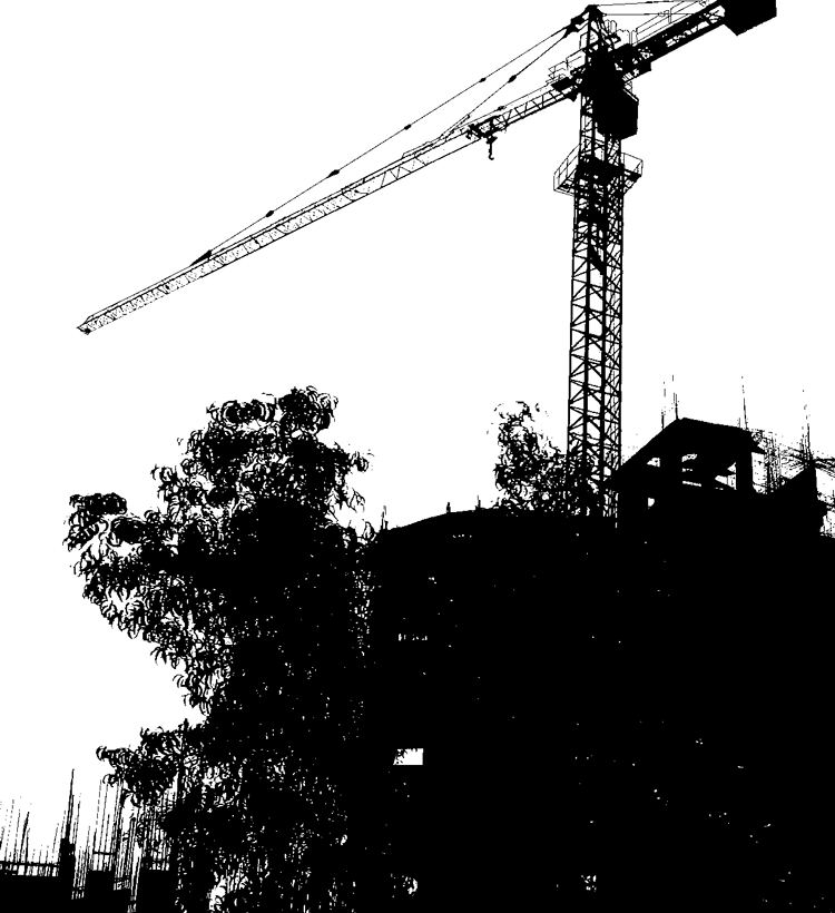 silhouette of crane at construction site