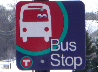 bus stop sign with googly eyes