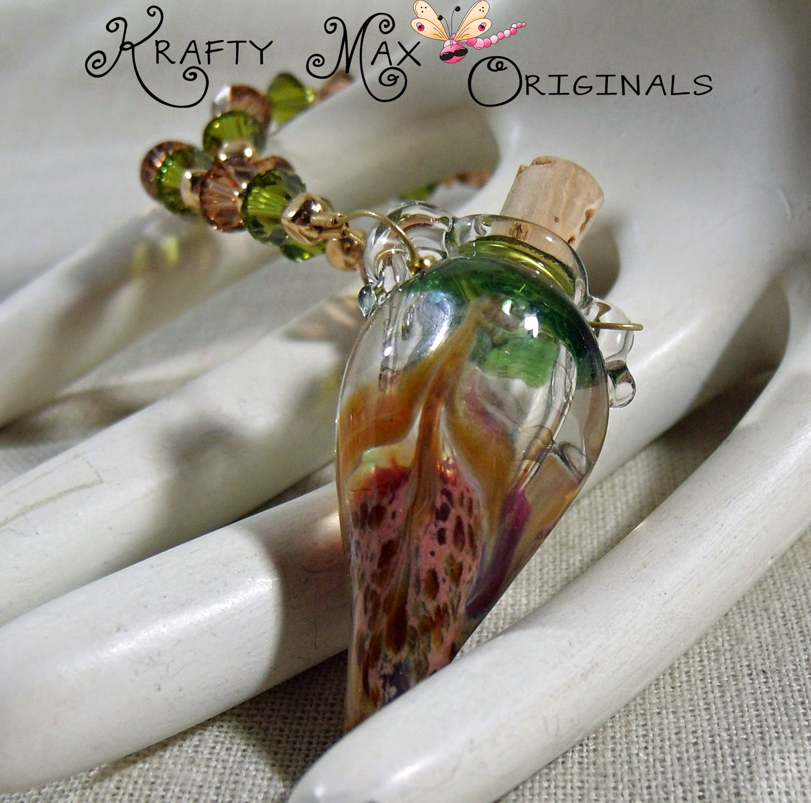 http://www.artfire.com/ext/shop/product_view/KraftyMax/9039649/isinglass_designed_lampwork_bottle_and_swarovski_crystal_necklace_set/handmade/jewelry/sets/lampwork
